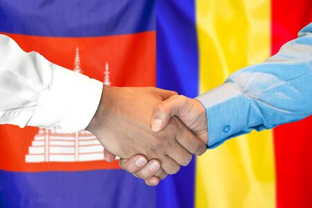 Business handshake on the background of two flags. Men handshake on the background of the Cambodia and Moldova flag. Support concept.
