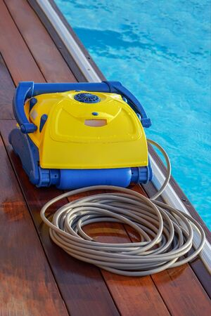 Pool cleaner during his work. Cleaning robot for cleaning the botton of swimming pools. Automatic pool cleaners.