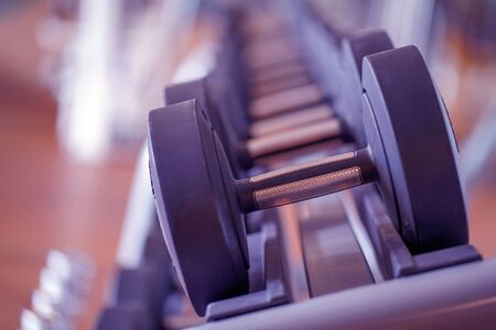 Closeup rows of dumbbells in the gym. Toning