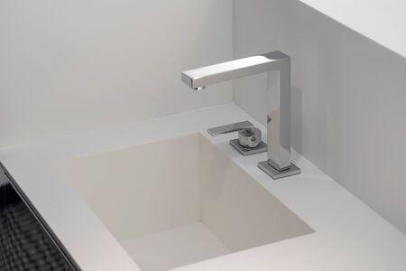 Bathroom interior sink with modern design in luxury hotel.