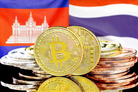 Concept for investors in cryptocurrency and Blockchain technology in the Cambodia and Thailand. Bitcoins on the background of the flag Cambodia and Thailand.