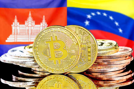 Concept for investors in cryptocurrency and Blockchain technology in the Cambodia and Venezuela. Bitcoins on the background of the flag Cambodia and Venezuela. 免版税图像