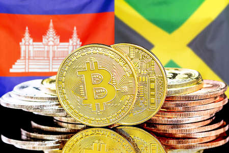 Concept for investors in cryptocurrency and Blockchain technology in the Cambodia and Jamaica. Bitcoins on the background of the flag Cambodia and Jamaica. 免版税图像
