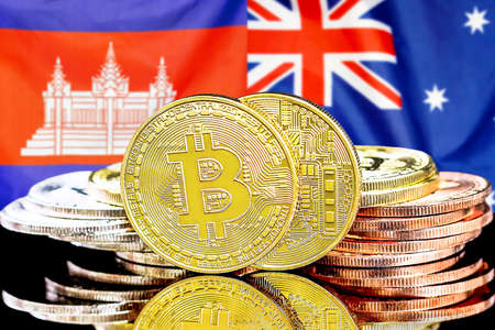Concept for investors in cryptocurrency and Blockchain technology in the Cambodia and Australia. Bitcoins on the background of the flag Cambodia and Australia.