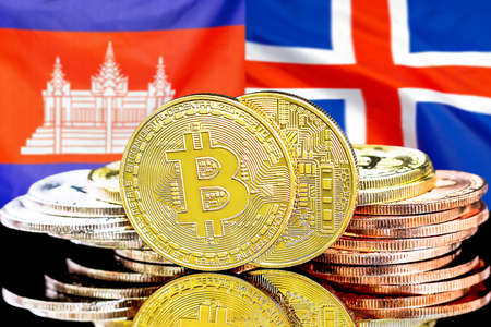 Concept for investors in cryptocurrency and Blockchain technology in the Cambodia and Iceland. Bitcoins on the background of the flag Cambodia and Iceland. 免版税图像