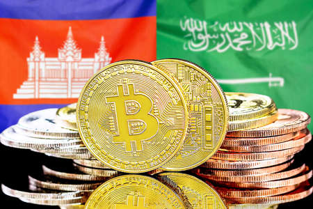 Concept for investors in cryptocurrency and Blockchain technology in the Cambodia and Saudi Arabia. Bitcoins on the background of the flag Cambodia and Saudi Arabia.