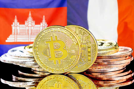 Concept for investors in cryptocurrency and Blockchain technology in the Cambodia and France. Bitcoins on the background of the flag Cambodia and France.