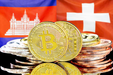 Concept for investors in cryptocurrency and Blockchain technology in the Cambodia and Switzerland. Bitcoins on the background of the flag Cambodia and Switzerland.