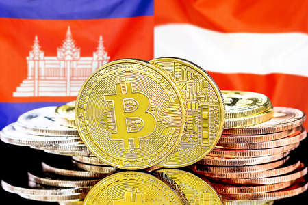 Concept for investors in cryptocurrency and Blockchain technology in the Cambodia and Austria. Bitcoins on the background of the flag Cambodia and Austria.