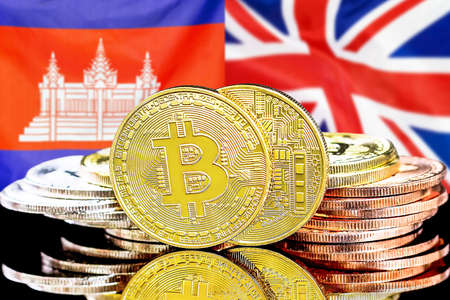 Concept for investors in cryptocurrency and Blockchain technology in the Cambodia and United Kingdom. Bitcoins on the background of the flag Cambodia and UK.