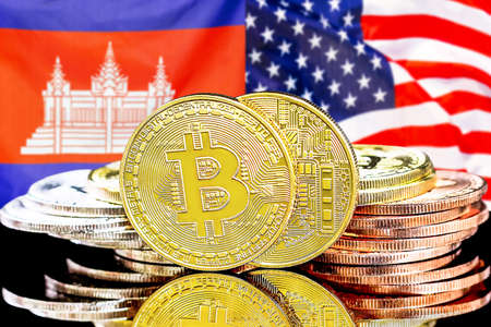 Concept for investors in cryptocurrency and Blockchain technology in the Cambodia and United States of America. Bitcoins on the background of the flag Cambodia and US.