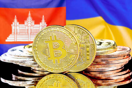 Concept for investors in cryptocurrency and Blockchain technology in the Cambodia and Ukraine. Bitcoins on the background of the flag Cambodia and Ukraine.