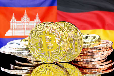 Concept for investors in cryptocurrency and Blockchain technology in the Cambodia and Germany. Bitcoins on the background of the flag Cambodia and Germany. Banque d'images