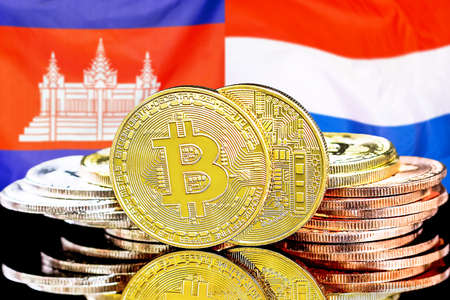 Concept for investors in cryptocurrency and Blockchain technology in the Cambodia and Netherlands. Bitcoins on the background of the flag Cambodia and Dutch.