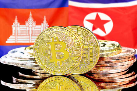 Concept for investors in cryptocurrency and Blockchain technology in the Cambodia and North Korea. Bitcoins on the background of the flag Cambodia and North Korea.