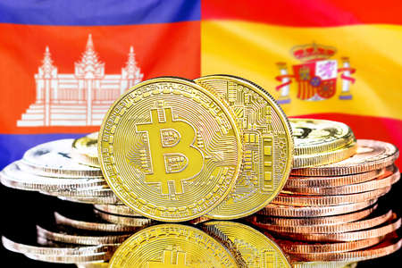 Concept for investors in cryptocurrency and Blockchain technology in the Cambodia and Spain. Bitcoins on the background of the flag Cambodia and Spain. Banque d'images