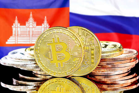 Concept for investors in cryptocurrency and Blockchain technology in the Cambodia and Russia. Bitcoins on the background of the flag Cambodia and Russia.