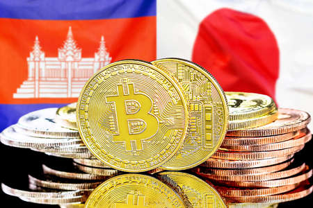 Concept for investors in cryptocurrency and Blockchain technology in the Cambodia and Japan. Bitcoins on the background of the flag Cambodia and Japan.