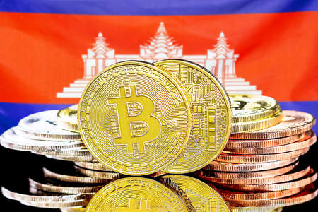 Concept for investors in cryptocurrency and Blockchain technology in the Cambodia. Bitcoins on the background of the flag Cambodia.