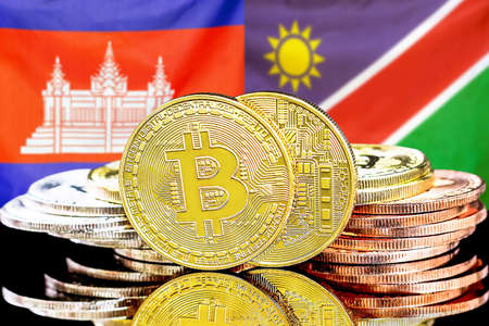 Concept for investors in cryptocurrency and Blockchain technology in the Cambodia and Namibia. Bitcoins on the background of the flag Cambodia and Namibia.