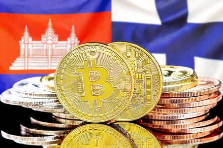 Concept for investors in cryptocurrency and Blockchain technology in the Cambodia and Finland. Bitcoins on the background of the flag Cambodia and Finland.