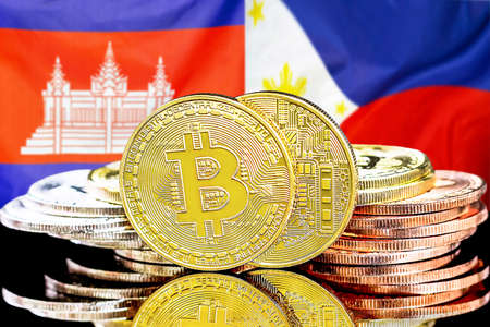 Concept for investors in cryptocurrency and Blockchain technology in the Cambodia and Philippines. Bitcoins on the background of the flag Cambodia and Philippines.