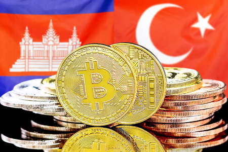 Concept for investors in cryptocurrency and Blockchain technology in the Cambodia and Turkey. Bitcoins on the background of the flag Cambodia and Turkey.