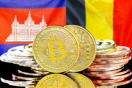 Concept for investors in cryptocurrency and Blockchain technology in the Cambodia and Belgium. Bitcoins on the background of the flag Cambodia and Belgium.