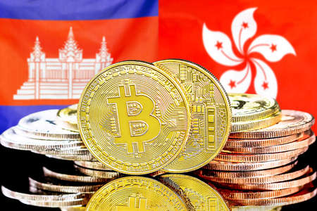 Concept for investors in cryptocurrency and Blockchain technology in the Cambodia and Hong Kong. Bitcoins on the background of the flag Cambodia and Hong Kong. Banque d'images