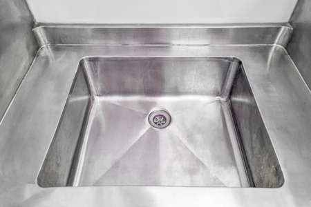 Stainless steel sink. Angle view of kitchen sink. Stainless steel sink for wash dishes and vegetables on kitchen.