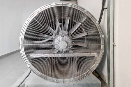 Large fan for ventilation. Industrial air conditioning and ventilation systems on a roof. ? loseup industrial ventilation fan