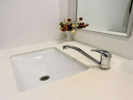 Washbasin interior sink with modern design. Public bathroom in the airport or restaurant, cafe. Bathroom interior sink with modern design.