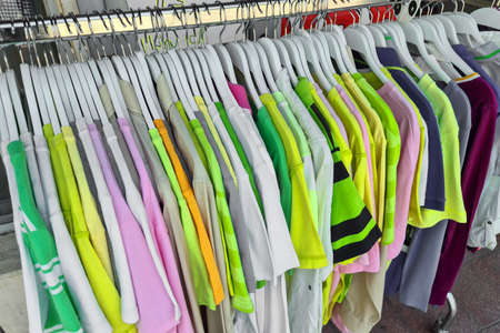 Fashionable clothing on hangers in shop. sport of T Shirts are hanging on Clothes Hanger, Colorful T Shirt. clothes hanger with t shirt.