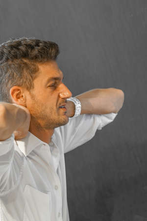 Male has neck pain. Closeup of a man in neck and shoulder pain and injury. Healthcare and medical concept. 免版税图像