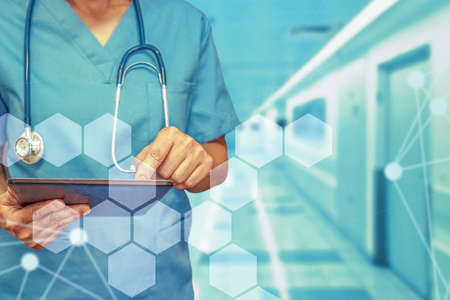 Healthcare and medicine. Surgeon or doctor using a digital tablet. Medical equipment or medical network. The doctor uses a digital tablet.
