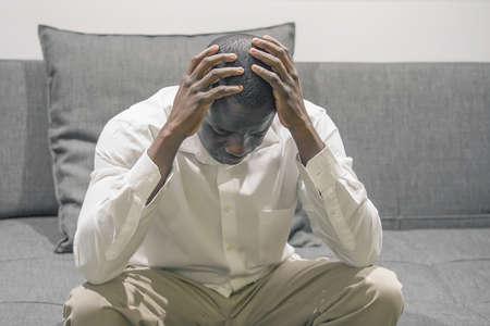 Sad face depressed african senior man. Very sad elderly man. Portrait of a sad elderly man close-up. Lonely african man is sad sitting on the bed at home. Man feel depression.