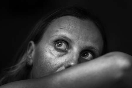 Black and white image of woman depression or domestic violence. People, grief and domestic violence concept. Closeup of unhappy scared crying woman. Stop the violence!