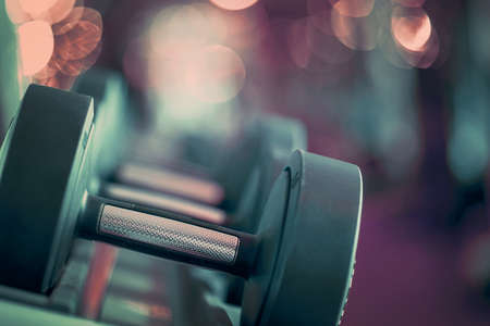 Closeup rows of dumbbells in the gym. Toning 免版税图像 - 153357978