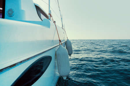 Sailing boat wide angle view in the sea. Yachting as a luxury sport and great vacation. Selective focus. 免版税图像