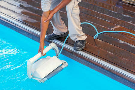 African Pool cleaner during his work. Cleaning robot for cleaning the botton of swimming pools. Automatic pool cleaners.