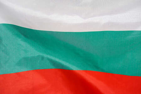 Fabric texture flag of Bulgaria. Flag of Bulgaria waving in the wind. Bulgaria flag is depicted on a sports cloth fabric with many folds. Sport team banner