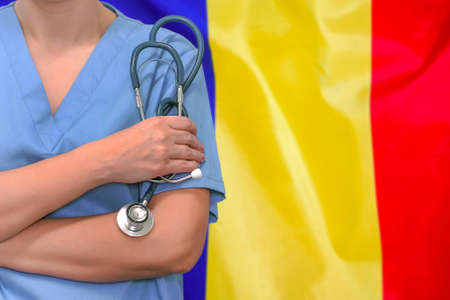 Female surgeon or doctor with stethoscope in hand on the background of the Moldova flag. Surgery concept in Moldova Foto de archivo