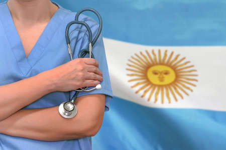 Female surgeon or doctor with stethoscope in hand on the background of the Argentina flag. Surgery concept in Argentina