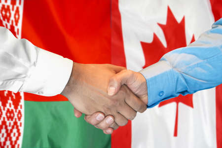 Business handshake on the background of two flags. Men handshake on the background of the Belarus and Canada flag. Support concept. 免版税图像 - 164280473