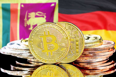Concept for investors in cryptocurrency and Blockchain technology in the Sri Lanka and Germany. Bitcoins on the background of the flag Sri Lanka and Germany.