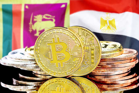 Concept for investors in cryptocurrency and Blockchain technology in the Sri Lanka and Egypt. Bitcoins on the background of the flag Sri Lanka and Egypt.