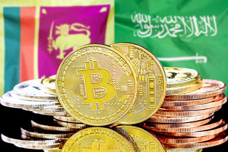 Concept for investors in cryptocurrency and Blockchain technology in the Sri Lanka and Saudi Arabia. Bitcoins on the background of the flag Sri Lanka and Saudi Arabia. Foto de archivo