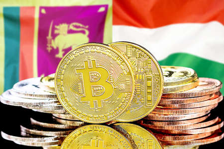 Concept for investors in cryptocurrency and Blockchain technology in the Sri Lanka and Hungary. Bitcoins on the background of the flag Sri Lanka and Hungary.