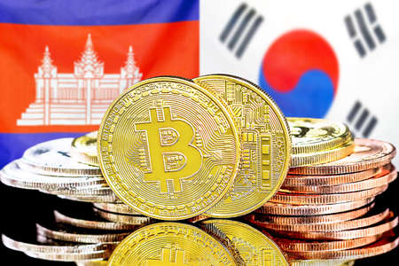 Concept for investors in cryptocurrency and Blockchain technology in the Cambodia and South Korea. Bitcoins on the background of the flag Cambodia and South Korea.