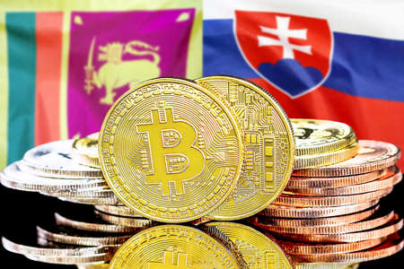 Concept for investors in cryptocurrency and Blockchain technology in the Sri Lanka and Slovakia. Bitcoins on the background of the flag Sri Lanka and Slovakia. Foto de archivo